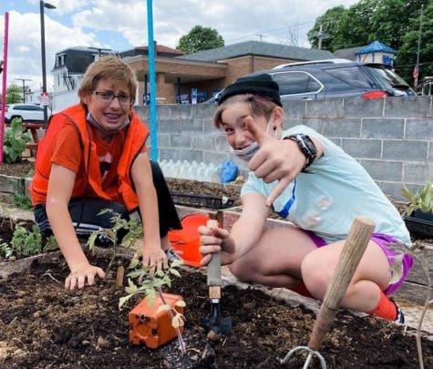 Quentin Umbnhauer and Kendra Umbenhauer are enjoying planting in the Pine Grove Community Garden.