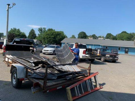 Hunter Legarht, senior, helping get rid of the old pavilion at Pine Grove
