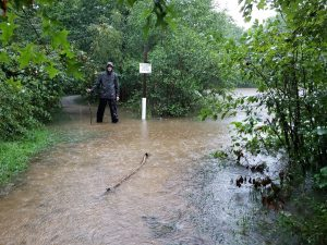 Levi Bettinger standing in approximately 18 in. of overflow on Wednesday, at Wagners Pond in Swatara State Park, Suedburg. Bettinger is standing on one of the trails that follow the banks of the pond.