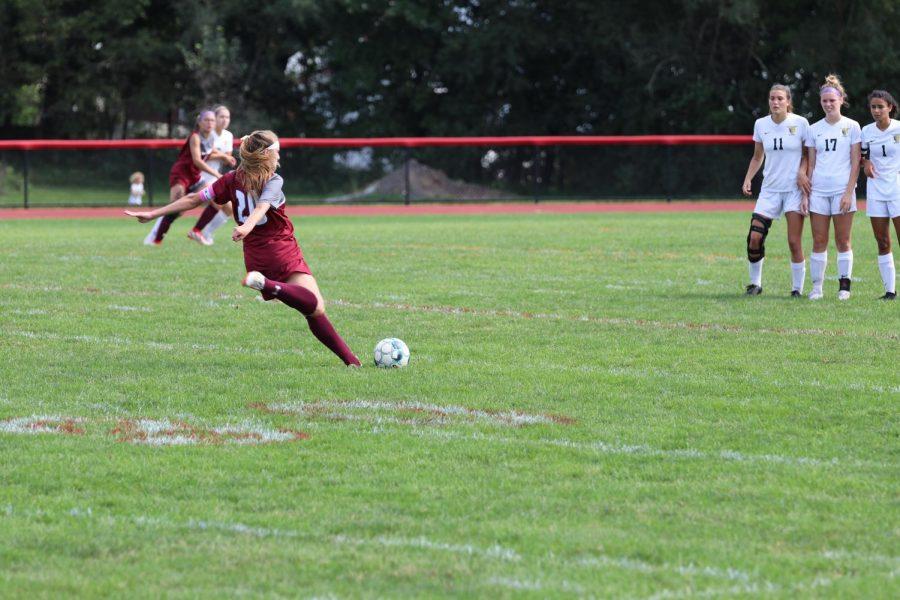 Abby Frew, senior, takes the direct kick.