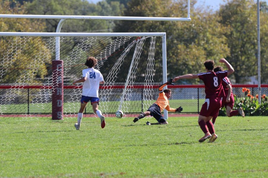 Quinn Broomer, freshman, looking to score while Damon Seiverling, freshman, cheers as the ball goes past the goalie.