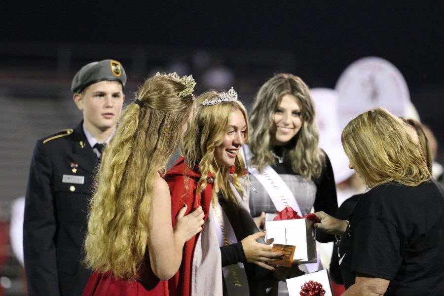 McKenna LeVan and Mrs.Hughes handing off the crown to the new Queen, Faith Wolff.